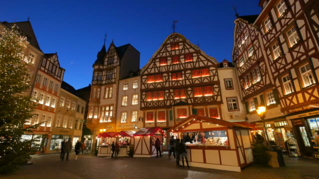 christmastime at the market square of bernkastel-kues, moselle valley, rhineland-palatinate, germany - three wheeled pushchair stock videos & royalty-free footage