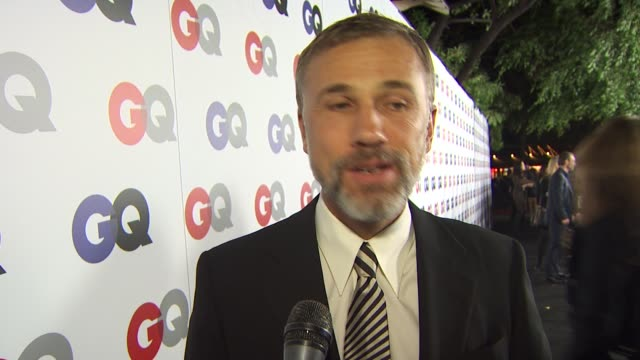 Christoph Waltz on how it feels to be honored as villian of the year how he considered the role complex rather than villainous and if being a badass...