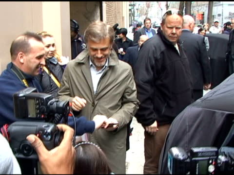 Christoph Waltz talks with fans as he departs 'Live with Regis Kelly in New York 04/20/11