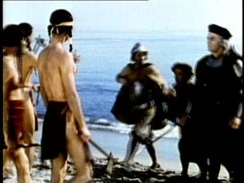 1948 reenactment montage christopher columbus and soldiers landing on beach and meeting natives at san salvador in the new world / audio - cristoforo colombo video stock e b–roll