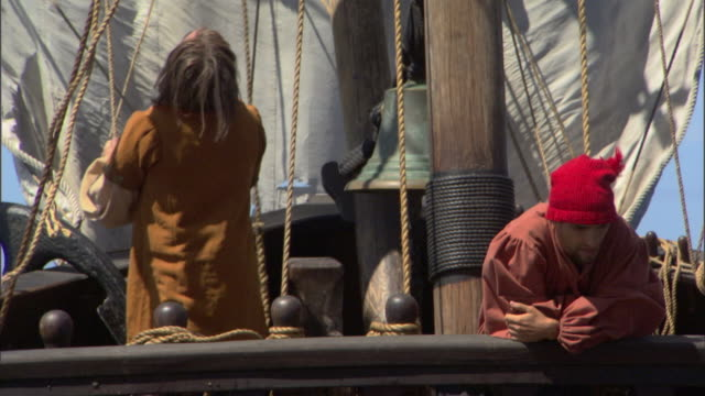 christopher columbus unties sails as sailors relax on the deck of  their ship. - cristoforo colombo video stock e b–roll