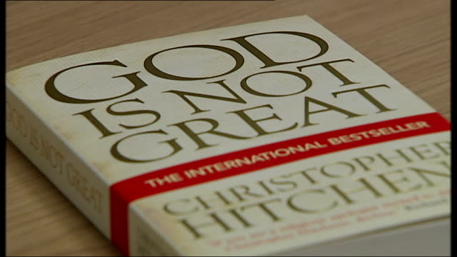 christopher hitchens dies at the age of 62 england london int close shot book by hitchens 'god is not great' - christopher hitchens stock videos & royalty-free footage