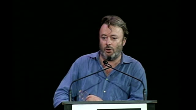 christopher hitchens dies at the age of 62 tx 1592005 baruch college int wide shot hitchens on stage for debate with george galloway about the iraq... - christopher hitchens stock videos & royalty-free footage
