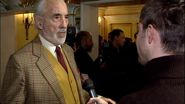 christopher lee posing for photos with wife birgit kroencke on red carpet and being interviewed. - christopher lee actor stock videos & royalty-free footage