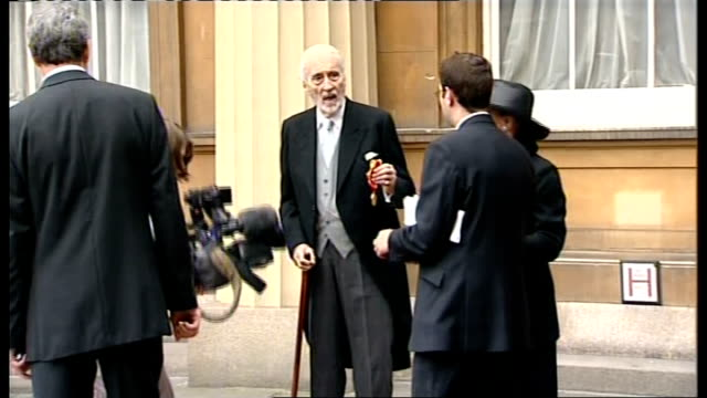 christopher lee receives knighthood: photocall and interview; christopher lee and wife birgit posing for photographers in courtyard of buckingham... - christopher lee actor stock videos & royalty-free footage