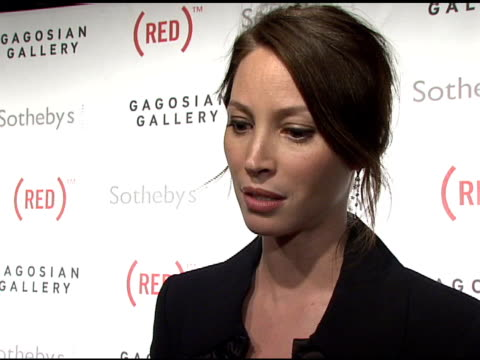 christy turlington on the idea behind the auction at the bono and damien hirst paint the town red for aids in africa the auction at sotheby's in new... - sotheby's stock videos and b-roll footage