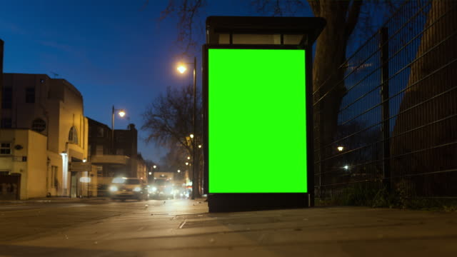 4k chroma key billboard an der bushaltestelle - billboard stock-videos und b-roll-filmmaterial
