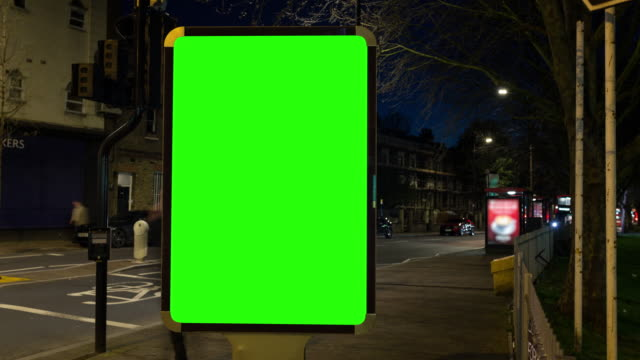 4k chroma key billboard on the street and time lapse traffic flow in the backgroundn - banner sign stock videos & royalty-free footage