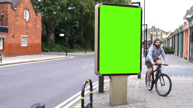 chroma key billboard on the street in the daytime - video collage video stock e b–roll