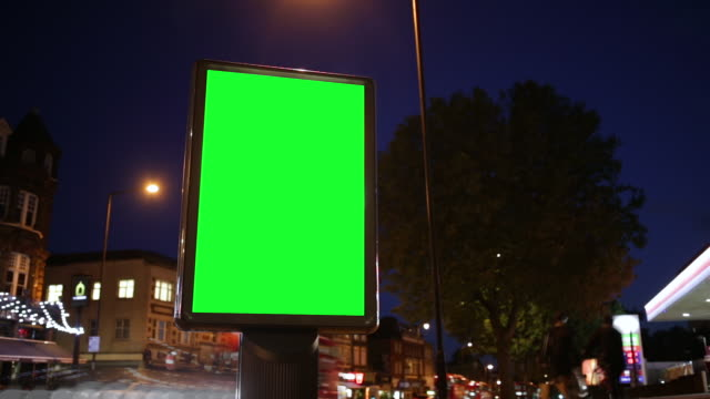 chroma key billboard on the street - tabellone video stock e b–roll