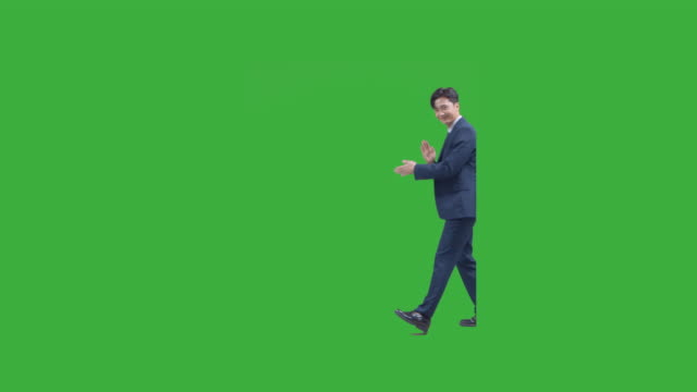 chroma key - business person walking as shaking his shoulders - green background stock videos & royalty-free footage