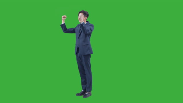 chroma key - businessman cheering up as clenching his fists - only men stock videos & royalty-free footage