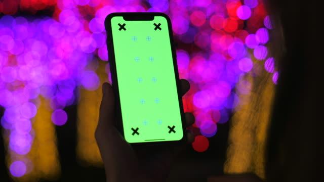 chroma key digital display on phone screen - holding stock videos & royalty-free footage