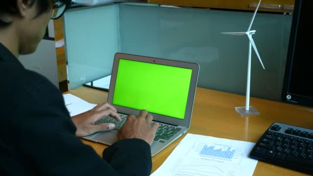 chroma key laptop, businessman typing on laptop computer at desk - computer key stock videos and b-roll footage
