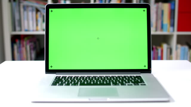 chroma key on laptop screen - table top view stock videos & royalty-free footage