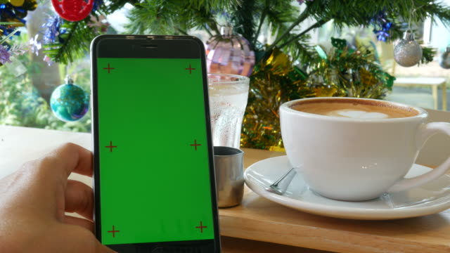 chroma key on mobile phone in coffee shop - tea cup stock videos and b-roll footage