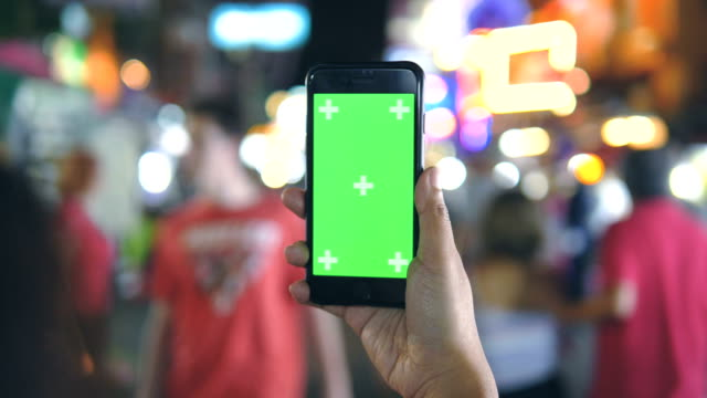 chroma key : smartphone at night city light bokeh background - green colour stock videos & royalty-free footage