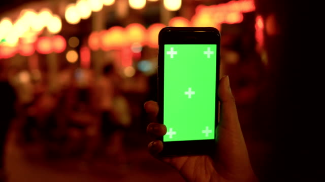 chroma key : smartphone at night city light bokeh background - template stock videos & royalty-free footage