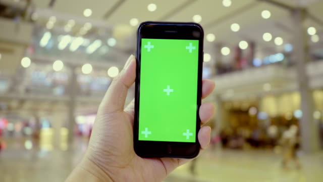 Chroma Key : Smartphone On Hand At Luxury Mall