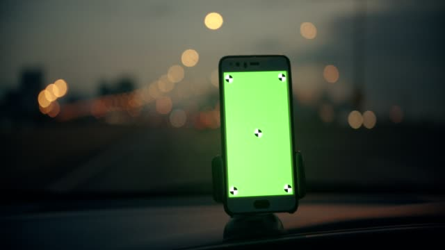Chroma key, woman using a navigator in the car