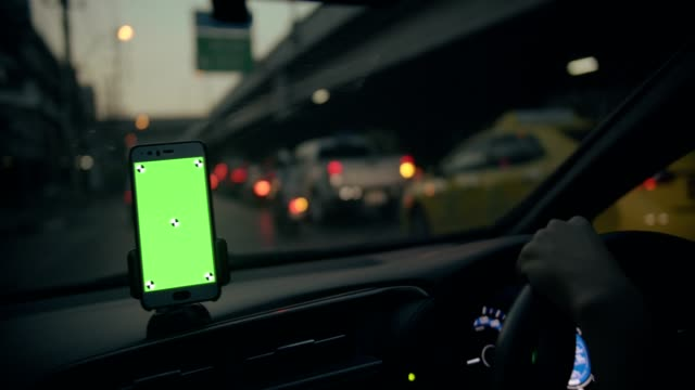Chroma key, Woman using smart phone with greenscreen while travel by car