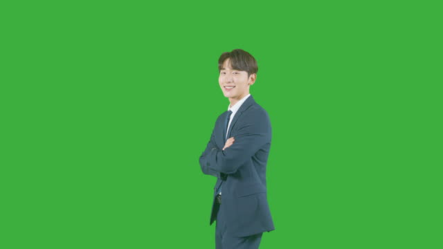 chroma key - young man making his arms outstretched and crossed - profile stock videos & royalty-free footage