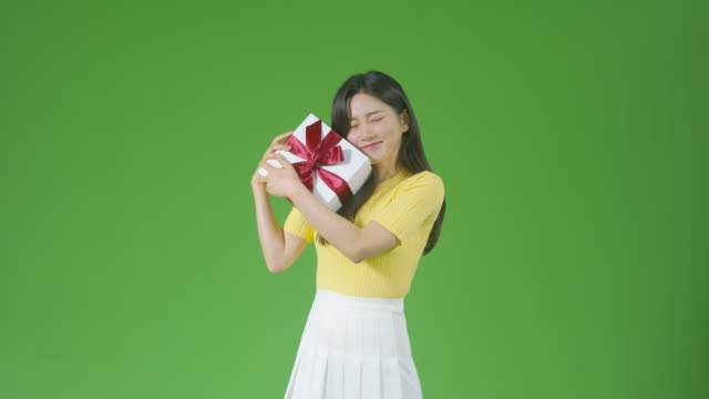 chroma key - young woman holding gift box and feeling happiness - receiving stock videos & royalty-free footage