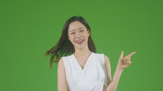 chroma key - young woman making hand gesture with feeling wind - black hair stock videos & royalty-free footage