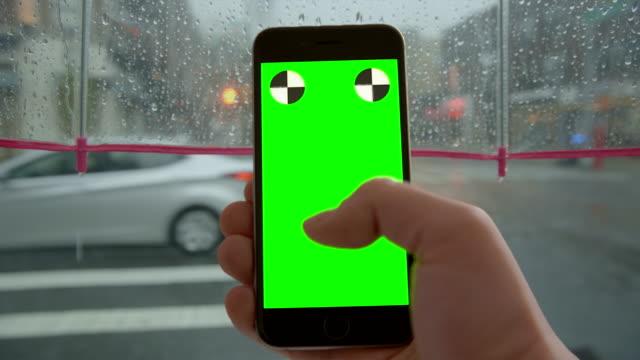 Chromakey smartphone hand texting surfing umbrella POV