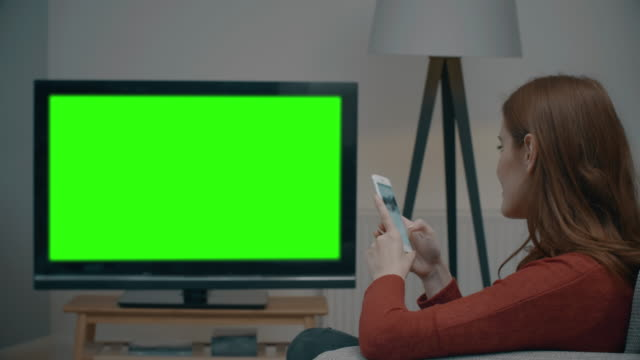 Chromakey TV and using phone.