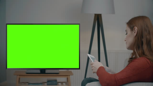 chromakey tv, tablet and credit card. - over the shoulder view stock videos & royalty-free footage