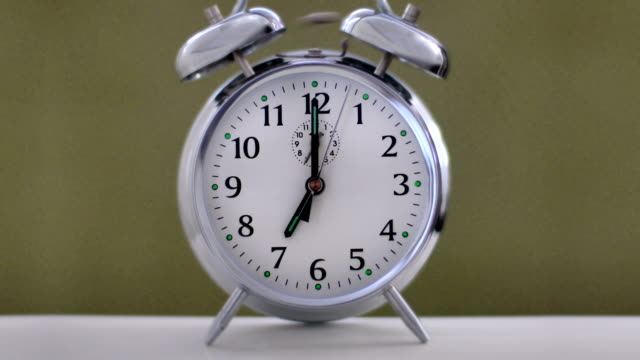 chrome alarm clock 7am. ring with sound. - bedtime stock videos & royalty-free footage