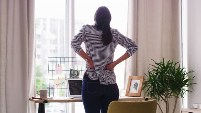 chronic back pain can take a major toll on your life - standing stock videos & royalty-free footage