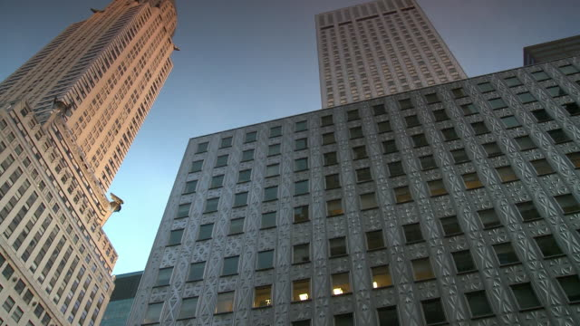 ws la pan chrysler building against blue sky / new york city, new york, usa - chrysler building stock videos and b-roll footage