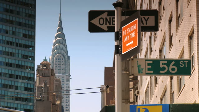 stockvideo's en b-roll-footage met ms chrysler building and 56th st sign daytime / new york city, new york state, usa  - straatnaambord