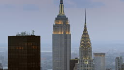 AERIAL Chrysler Building and the Empire State Building at dusk