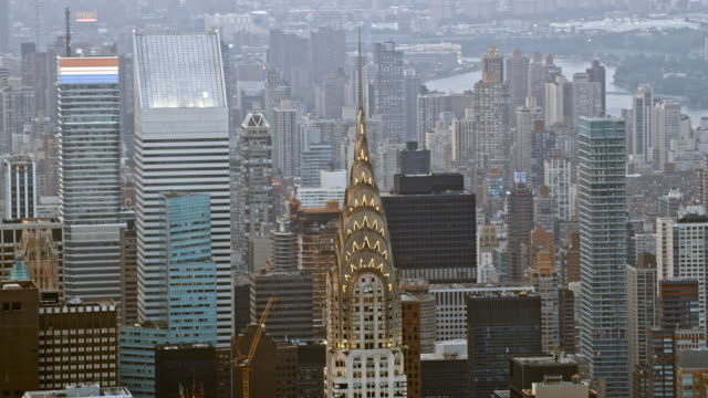aerial fast-mo chrysler building in nyc - international landmark stock videos & royalty-free footage