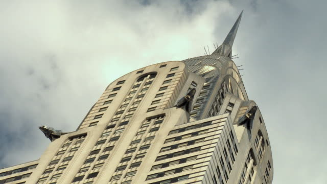 T/L CU LA Chrysler Building with clouds rushing over spire / New York City, USA