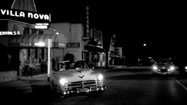 a 1953 chrysler roadster turns into oncoming traffic and nearly causes an accident on sunset strip in california. - sunset boulevard stock-videos und b-roll-filmmaterial