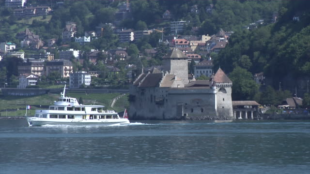 château de chillon and an excursion boat on lake geneva - montreux stock videos & royalty-free footage