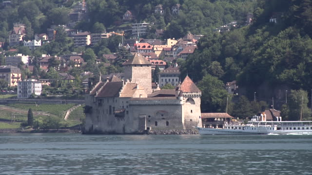 château de chillon and an old  excursion boat on lake geneva - montreux stock videos and b-roll footage