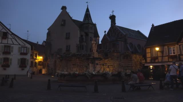 vidéos et rushes de pan / château saint-léon, st leon church and fountain at chateau square - village