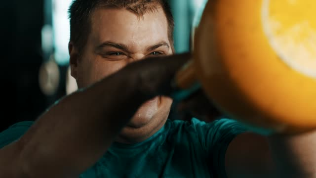 chubby man doing exercise with keetlebell in gym - overweight active stock videos & royalty-free footage