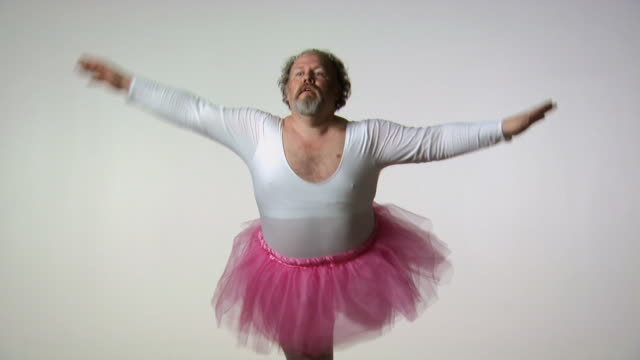 Chubby man in tutu ballet dancing