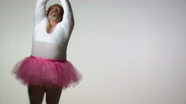 chubby man in tutu ballet dancing - ballettröckchen stock-videos und b-roll-filmmaterial