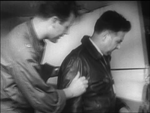 Chuck Yeager showing man parts of Bell X1 airplane / California / newsreel