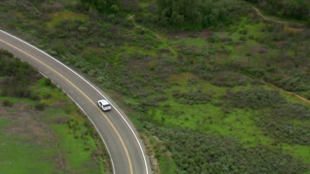 chula vista, ca, u.s. - drone view of lone car on road in otay lakes county park, on thursday, april 2, 2020. - named wilderness area stock videos & royalty-free footage