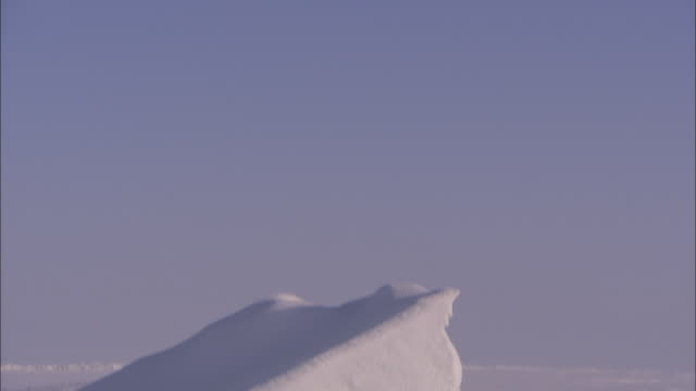a chunk of ice juts from a snowy, flat alaskan plain. - flat stock videos & royalty-free footage