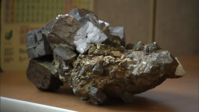 a chunk of ore occupies a shelf. - metal ore stock videos & royalty-free footage