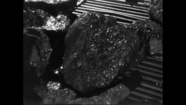 vidéos et rushes de montage chunks of coal moving along a conveyor belt and a colliery / united kingdom - coal
